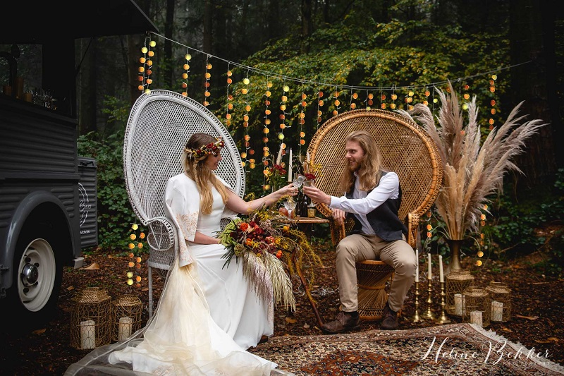 Woodland wedding seating with peacock chairs
